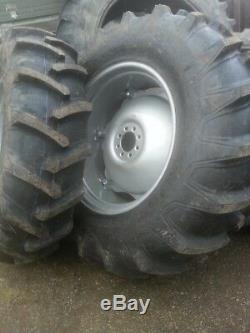 TWO 14.9x28,14.9-28 FORD TRACTOR 4000 Tires with6 Loop Wheels with Centers